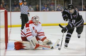 Ryan McKay stops a shot by Minnesota State's Matt Leitner in NCAA Regional action. (Toledo Blade: Andy Morrison)