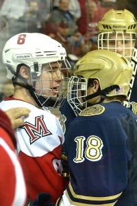 Matthew Caito confronting a Notre Dame player as a freshman (photo by Cathy Lachmann).