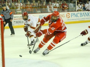 Kevin Morris knocks home the clinching empty-net goal on Friday (photo by Cathy Lachmann).