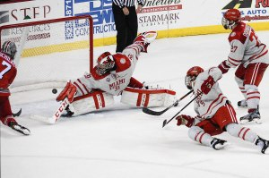 Miami goalie Ryan Larkin made this third-period save to preserve the tie (photo by Cathy Lachmann/BoB).