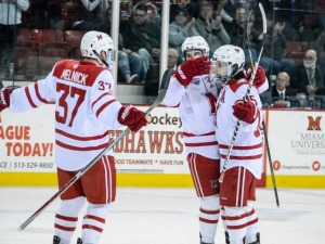 From left to right, Josh Melnick, Kiefer Sherwood and Anthony Louis celebrate a Louis goal (photo by Cathy Lachmann/BoB).
