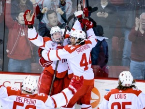 Miami celebrates after Josh Melnick's overtime game winner (photo by Cathy Lachmann/BoB).