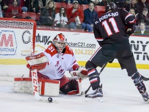 Ryan Larkin makes one of his 28 saves on Saturday (Cathy Lachmann/BoB).