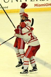 Sullivan celebrates a goal by fellow defenseman Chris Joyaux (photo by Cathy Lachmann/BoB).